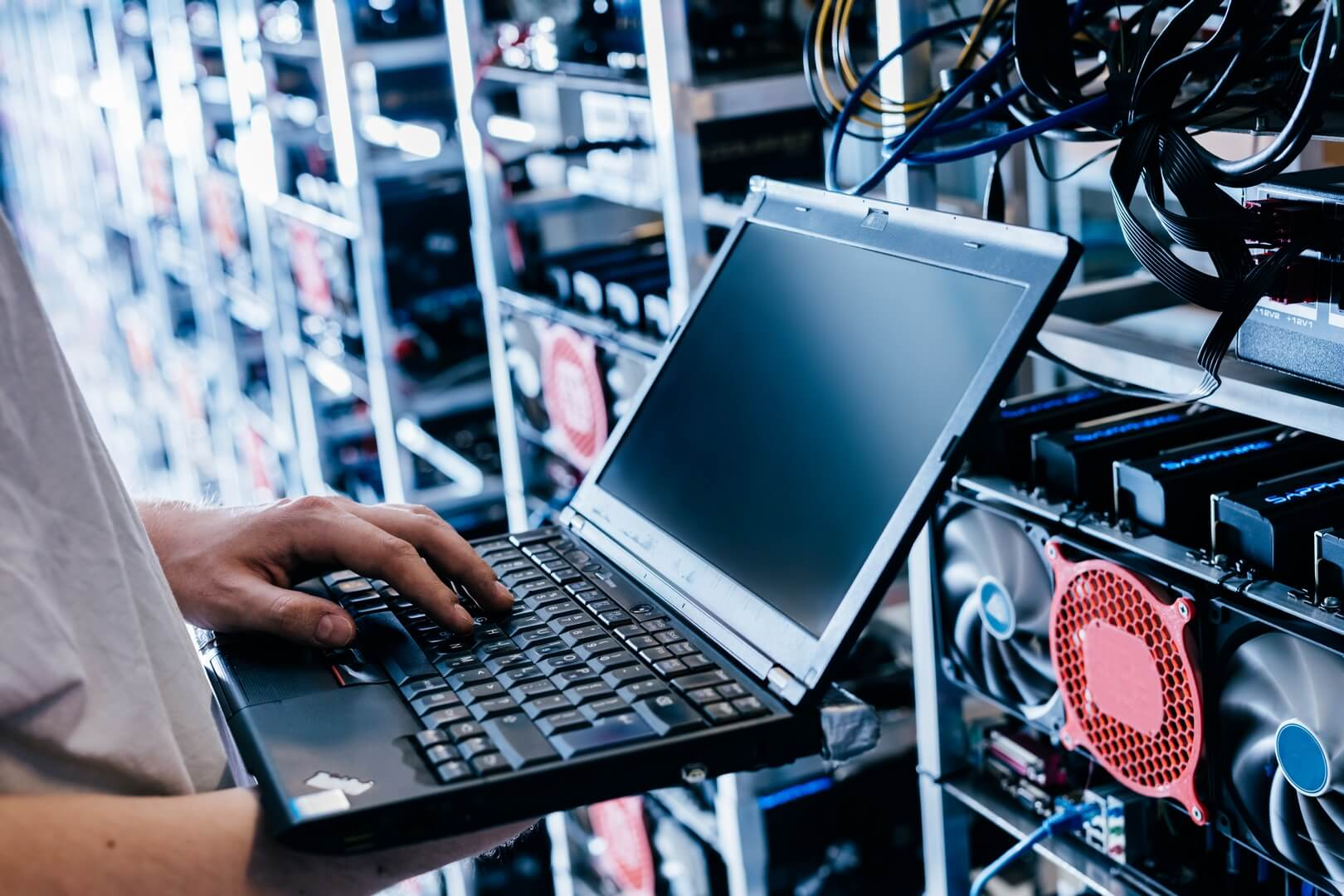 it-specialist-working-on-computer-in-bitcoin-and-crypto-currency-mining-farm